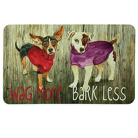 This Kitchen Mat from Bacova features a whimsical dog print and is soft to the touch. Displays the words Wag More Bark Less.
