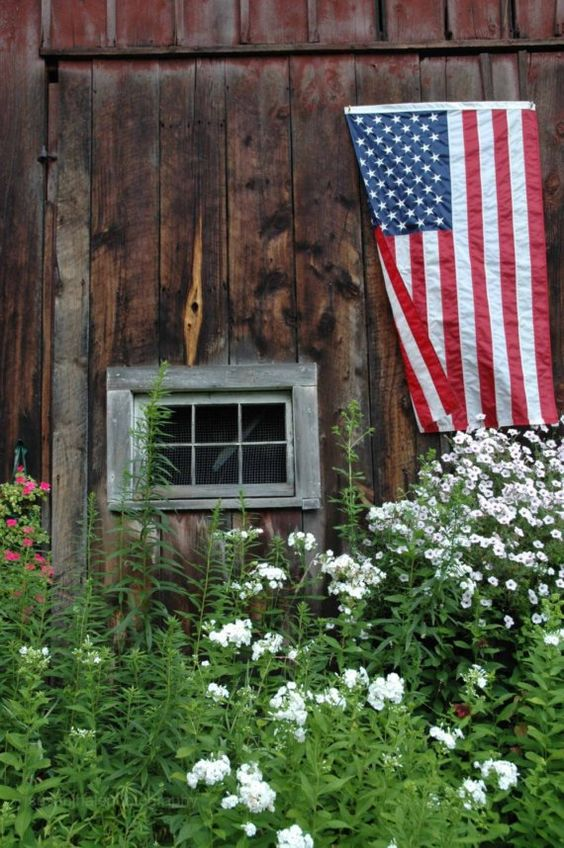 Rustic barn and flag