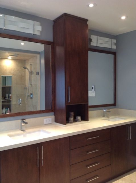 Custom vanity with linen tower and quartz countertop. Mirror frames ...