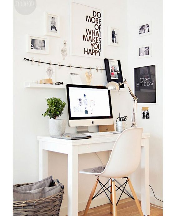 Make a corner nook look bigger by placing a small desk in the center and then covering the surrounding area with art. Hang a small shelf on the wall for your office accessories, and complete the look with a plant and cool lamp.