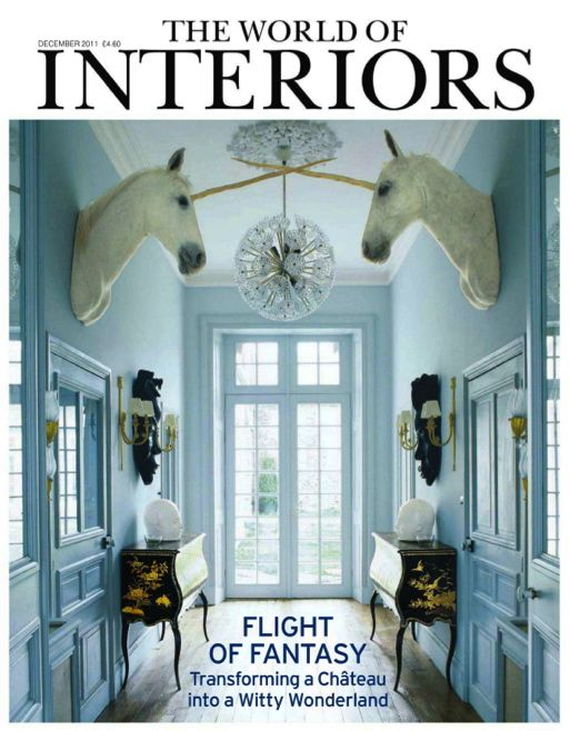 Unicorn heads in the entry - The World of Interiors magazine