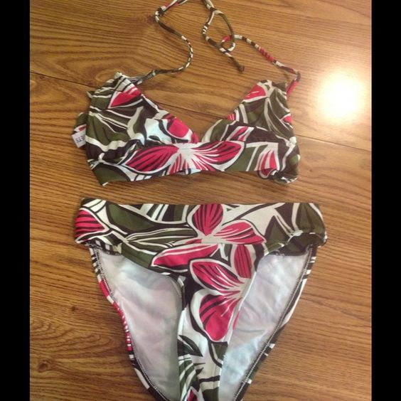 Sunsets bikini Sunsets bikini size small. Green, pink and white tropical pattern. The top ties in the back and at the neck. Good condition Sunsets Accessories