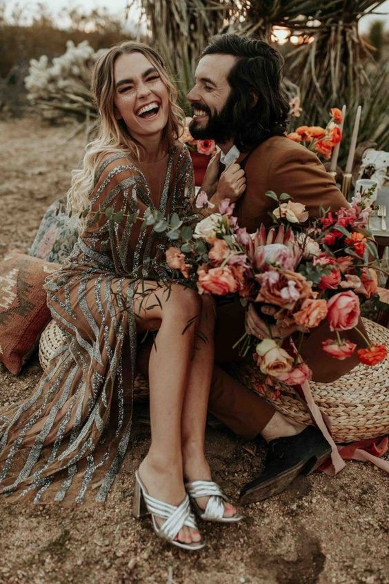 This boho glam meets desert wedding inspiration couple is all smiles at the stunning Joshua Tree National Park | Image by Karra Leigh Photo