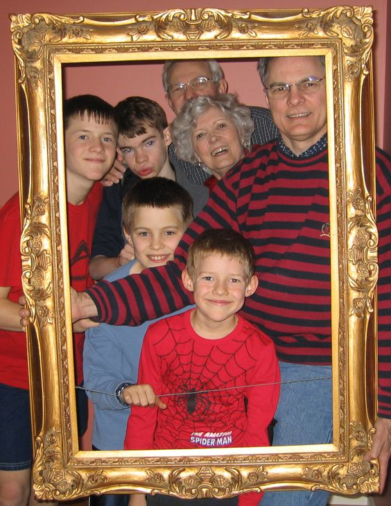 Intergenerational family photo using a frame