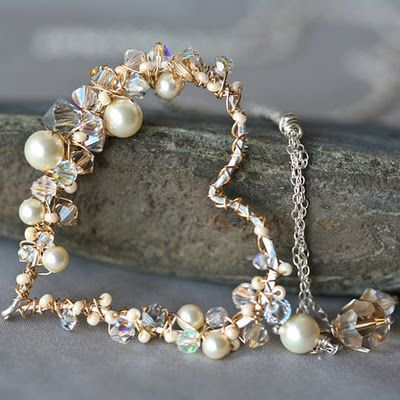 Heart necklace with lavender colored glasses and pearls