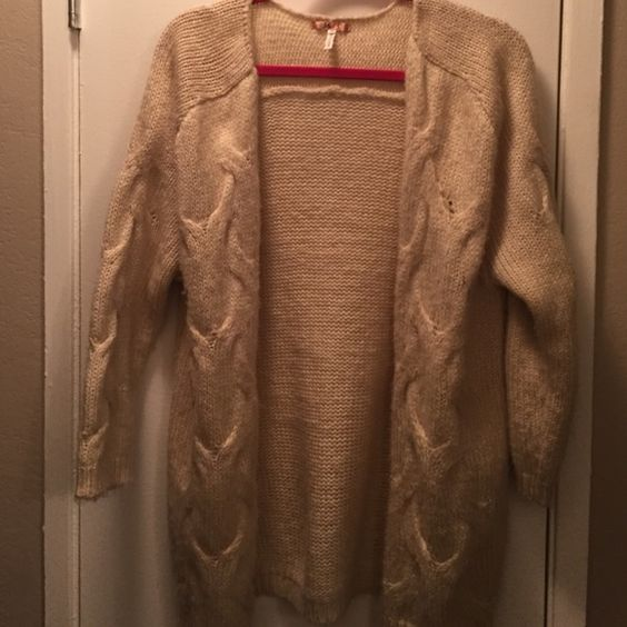 Cream knit long cardigan Only worn once. Great condition! From urban outfitters Urban Outfitters Sweaters Cardigans