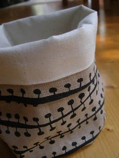 Little fabric buckets - add two handles, a monogram. . .  and boy, we are in business