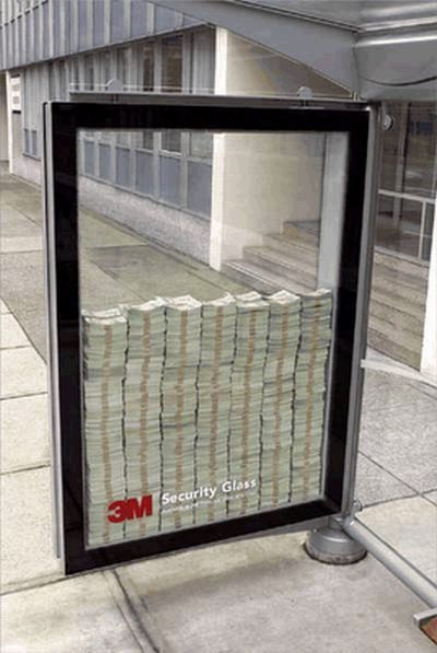3M Security Glass Ad - This a bold display of bus stop advertising.  That is actual money inside of the glass case.