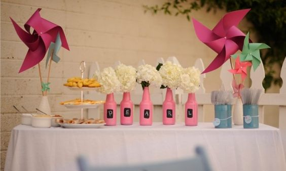 Like the pink bottles with baby's name... First birthday party