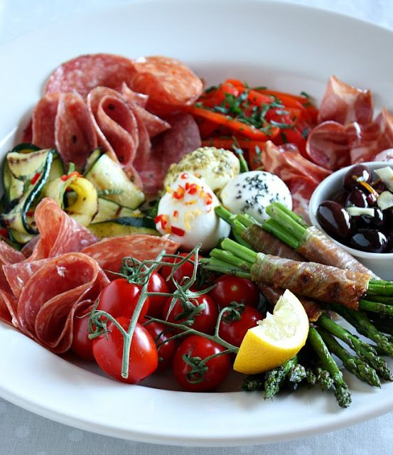 Classic Antipasto: three or four varieties of salami, slices of prosciutto, slices of cooked ham, slices of mortadella and provolone cheese. A variety of olives, fresh cooked asparagus, oil and garlic marinated red peppers, cut in strips; oil and garlic marinated artichoke hearts, hearts of palm Marinated mushrooms Marinated cauliflower florets