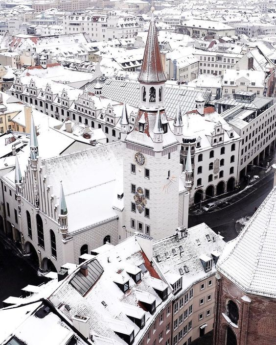 """""""I woke up early on the first big snowfall of the season to find Munich draped in white. I raced to the city centre and was the first person on top of St. Peter's Church. The silence of the early morning and the pristine rooftops were even more picturesque than I had hoped. At that moment I had a whole winter wonderland just to myself."""" -@mjcskye Munich Germany #passionpassport by passionpassport"""