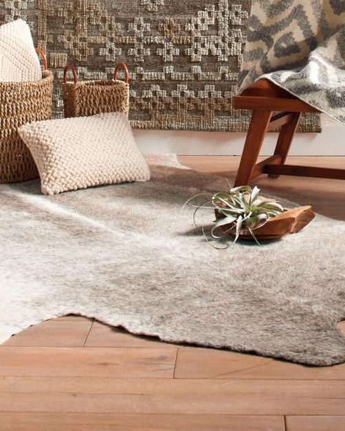 11 Cozy Rugs So Soft You Ll Want To Sleep On Them Faux Cowhide Rug Cow Hide Rug Faux Cowhide