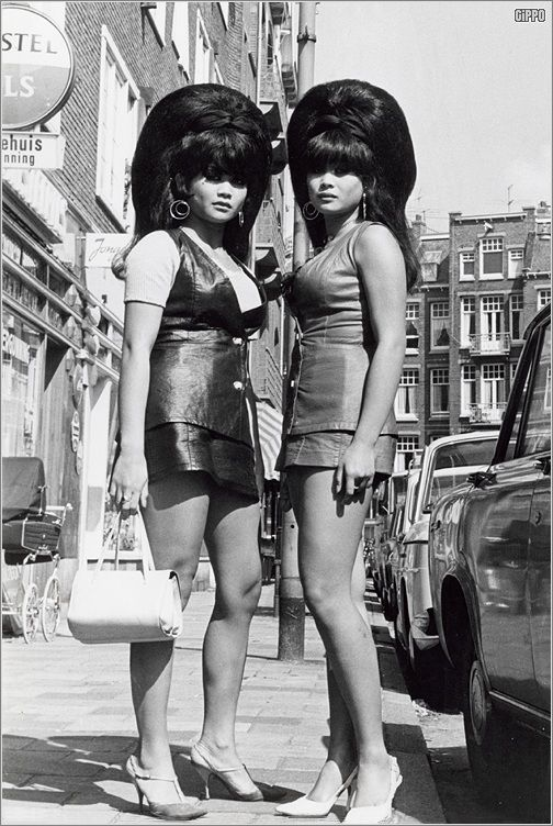 Thai twins with big beehives in Amsterdam in the 60's.: