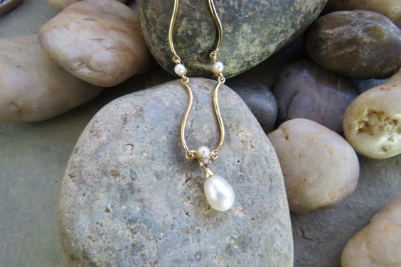 Hey, I found this really awesome Etsy listing at https://www.etsy.com/listing/208306407/vintage-14kt-gold-pearl-and-diamond