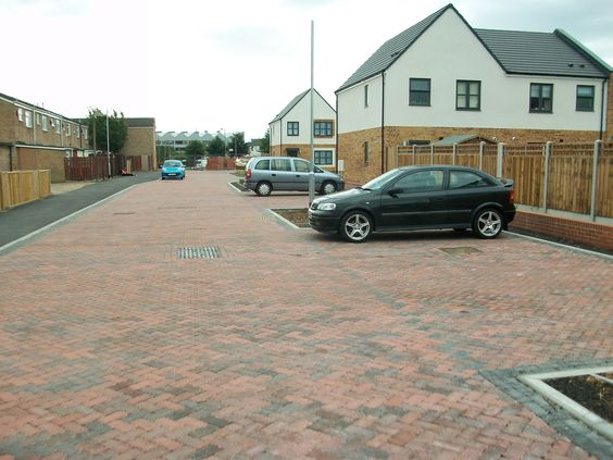 Brett has supplied permeable Omega Flow paving in two variants.  The central paving areas have been supplied in 80mm Brindle blocks, while borders are specified in 60mm Charcoal.  This design ensures that surface water run-off is directed towards the paving that offers greater permeability, as well as providing visual contrast to enhance the overall aesthetics of the development.