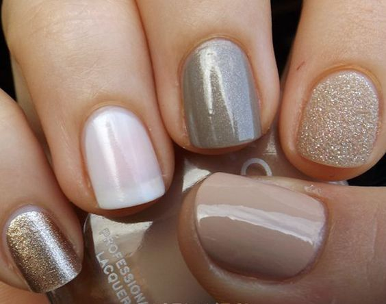 If you don't have a perfect gradient of colors in your nail arsenal, go for a look like this. Keep the colors in the same family and add some glitter. Voila!