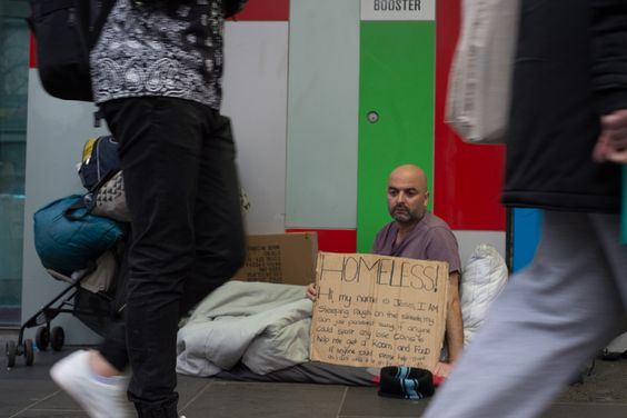 I wanted to have people either side of me as I thought it was a very typical picture of a homeless person however I decided that to show the possessions was more important