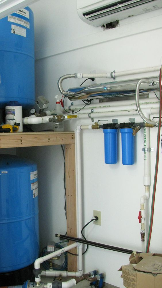 Rainwater collection filtration system. www.bluehorsebuilding.com - Find us on Facebook / Blue Horse Building + Design: