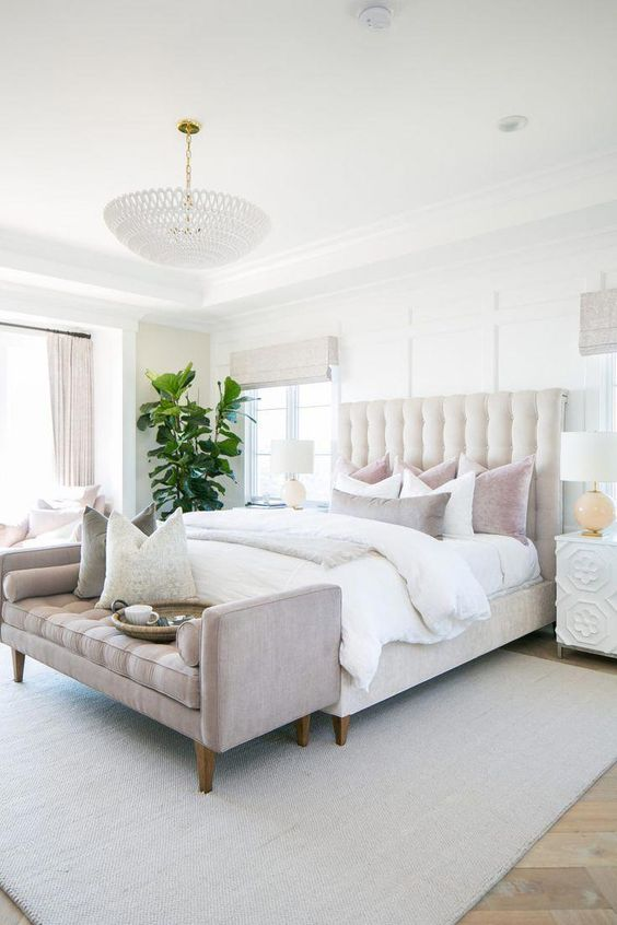 elegant master bedroom decor with pink velvet bench at end of bed, neutral bedroom design, neutral Master Bedroom decor with white walls, white bedding, nightstand decor, and upholstered headboard, traditional glam bedroom decor #dreambedroom