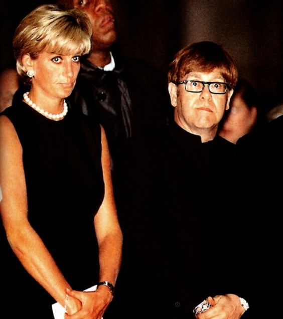 July 22, 1997: Diana, Princess of Wales beside British pop-star, Elton John during the memorial mass for murdered Gianni Versace, in Milan.