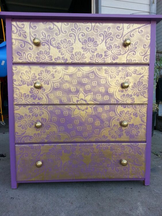 Spray painting an old lace table cloth onto a painted dresser