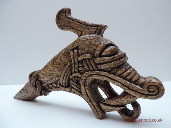 Viking dragon head wood carving