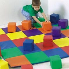 """Patchwork Crawley Activity Mat, Primary  Same deluxe 2""""-thick foam construction as the ABC Crawley Mat. 60"""" square. Hygienic mat for resting, beginning tumbling and play. Vinyl cover wipes clean easily."""