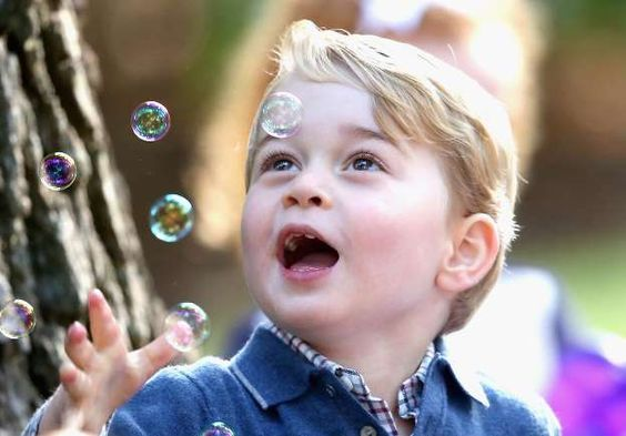 Prince George of England playing with bubbles in Canada