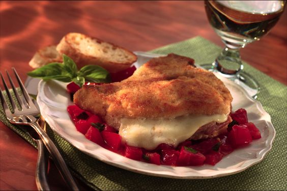 Make these gourmet-looking stuffed veal chops with an easy recipe that uses a handmade breading mix and fills each chop with tons of sliced prosciutto and Sargento® Sliced Swiss Cheese (that will melt to gooey perfection in the oven). These chops are served with stewed tomatoes made with fresh basil and an anchovy filet on top.