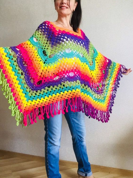 Excited to share this item from my #etsy shop: Crochet Poncho Women Plus Size Rainbow Festival Pride Vegan Clothing Fringe, Hippie Poncho bohemian clothing, Hand Knit Boho Wraps #clothing #rainbow #bohohippie #crochetponcho #womenponchocape #plussizeclothing