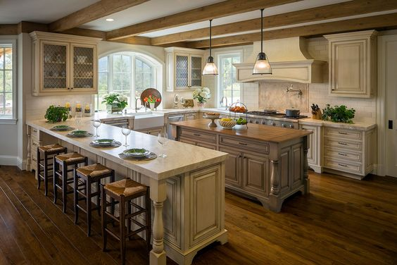 French country kitchen, exposed beams, subway tile, cream cabinets, mesh insert glass front cabinets, apron front/farm sink...: