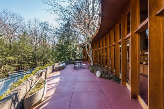 TIRRANNA, A Frank Lloyd Wright mid century masterpiece built in 1955. Classic hemicycle design overlooking the Noroton River in New Canaan, Connecticut.