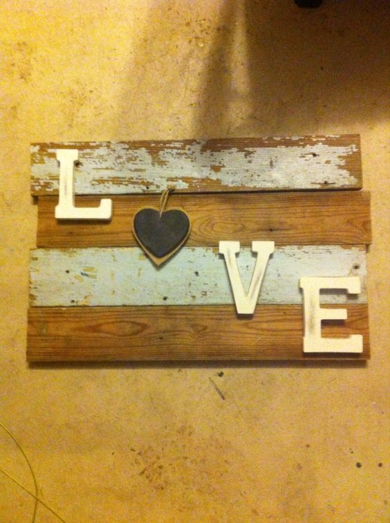 Sign made from 100 yr old farm/barn wood.