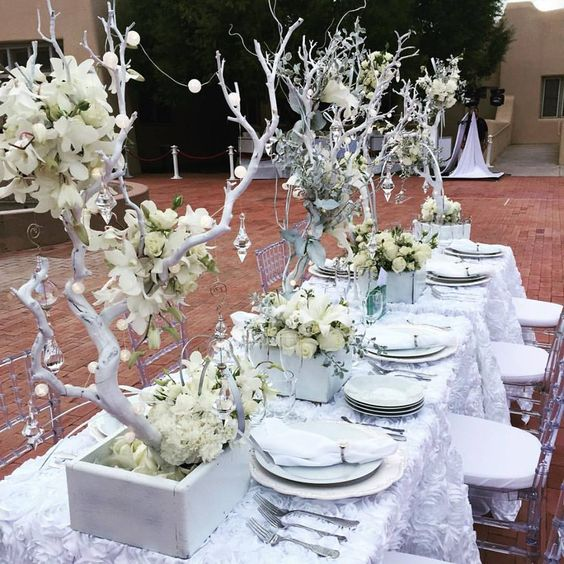 We LOVE this tablescape from Diner en Blanc Albuquerque.  Add dimension to your table design by adding height and texture with your decorations.:
