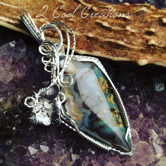 Blue plumes! Prudent man plume agate! Wrapped in Aegentium silver