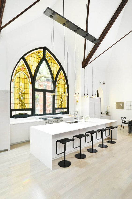 Giant stained glass windows in black and white kitchen