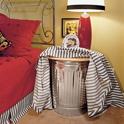STORE YOUR BULKY OUT OF SEASON BLANKETS OR SWEATERS IN A (NEW) METAL TRASH CAN CONCEALED BY FABRIC. THIS IS FRUGAL CREATIVE END TABLE THAT MAKES THE MOST OF EVERY INCH OF SPACE.