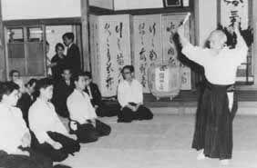Ueshiba Morihei conducting a lecture