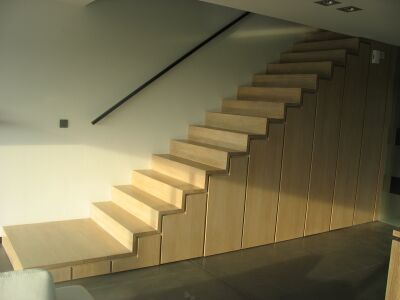 staircase finished with wooden/plywood cabinets