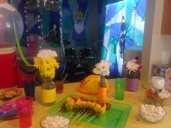 Adventure Time #Party: #Food table with #cake, rainbow fruit kabobs, veggies and dip, cinnamon buns, and treetrunks' mini apple pies (pillsbury apple turnovers :)   ). With Ice King Castle backdrop.