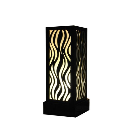This beautiful lamp features a black colored frame with natural cotton as a liner. This is a style that is both modern and elegant to fit any home decor. Designed with fire flame pattern, this lamp is made of good quality MDF carving is one of the table lamps which shows estetic element suitable for your room.