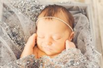 smiling-newborn-babygirl-with-sparkle-headband