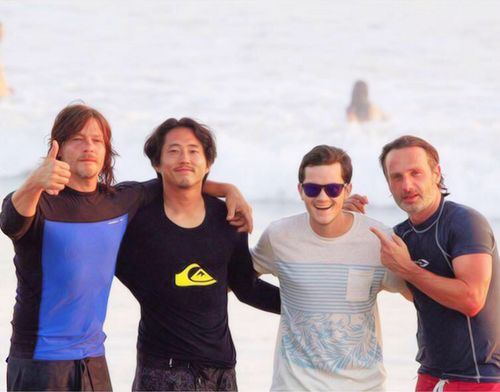 Norman Reedus, Steven Yeun & Andrew Lincoln with fan on the beach in Costa Rica (August 5)
