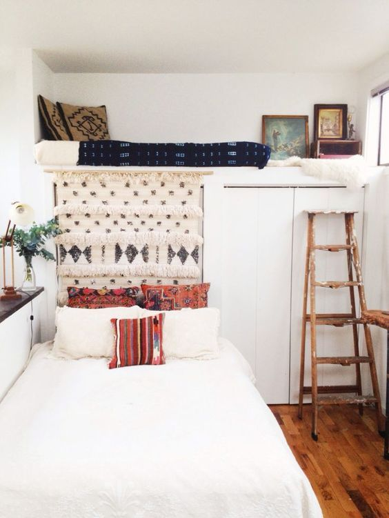 Small bedroom with unusual nook for naps or additional bed