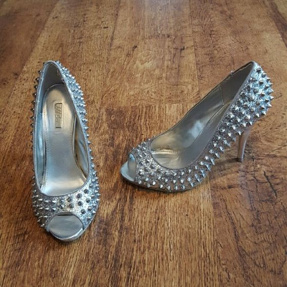 Silver Spiked Glitter Heels Never worn, only tried on. Size 8. Peep toe. Silver glitter and spikes. By Wildpair. No box but the bottom tags are still there. Wild Pair Shoes Heels