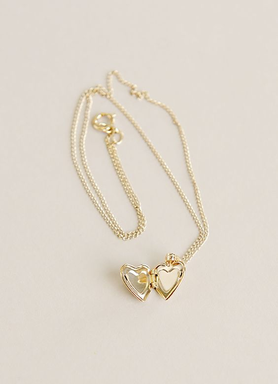 Give her a simple charm that can hold her world, like our Gold Diamond Heart Locket.  https://www.onesmallchild.com/gold-heart-diamond-locket.html