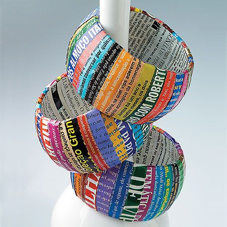 Recycled magazine bracelets... I feel like old black and white fashion pics would look cute: