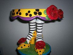 I have a love of cake plates with something interesting on the pedestal base. Have several with shoes but this one is one of my favorites for it's sense of whimsy.