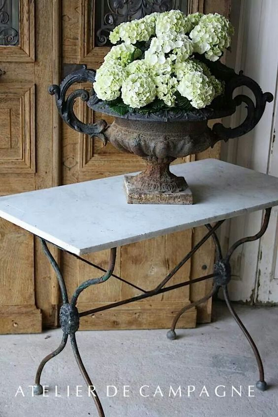 white hydrangeas crusty vintage urn french style gorgeous vignette
