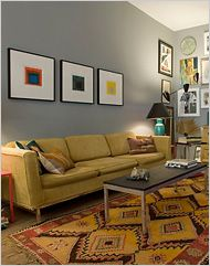 love the grey walls, simple prints/paintings and that 50s sofa.